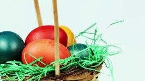 stock-footage-easter-eggs-background-colorful-easter-eggs-in-a-basket-with-green-grass-decoration-white-300x168