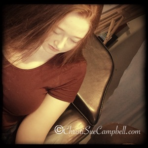 Linds watches as she has her tattoo done. She wanted to be the first to go, since today was for her.